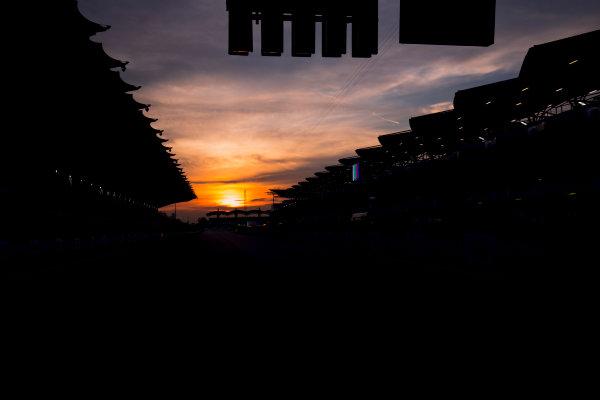 Sepang International Circuit, Sepang, Malaysia. Friday 29 September 2017. Sun rises at the Sepang Circuit. World Copyright: Zak Mauger/LAT Images  ref: Digital Image _56I2068