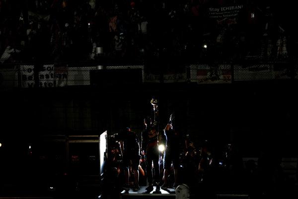 Suzuka Circuit, Suzuka, Japan.9th October 2011.Sebastian Vettel, Red Bull Racing RB7 Renault, 3rd position, celebrates his second world championship with his team. Portrait. Atmosphere. World Copyright: Andy Hone/LAT Photographicref: Digital Image CSP26065