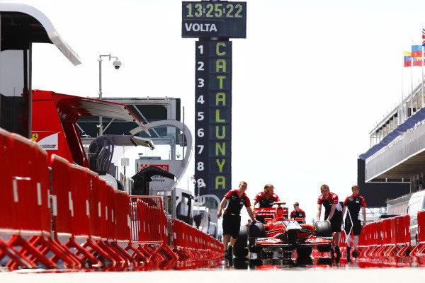 Circuit de Catalunya, Barcelona, Spain19th May 2011Marussia Virgin Racing mechanics push the car down the pit lane.World Copyright: Charles Coates/LAT Photographicref: Digital Image _X5J7623
