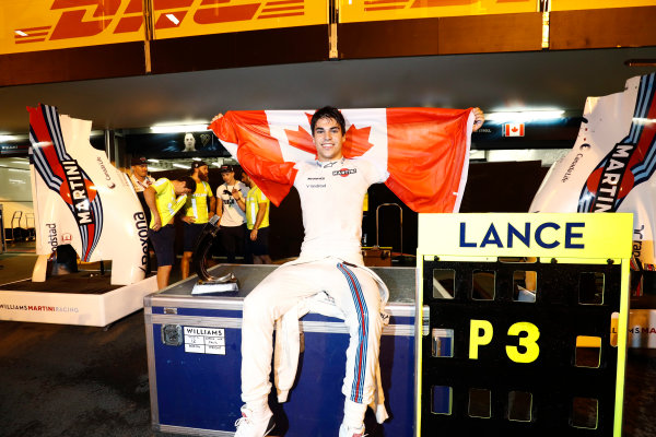 Baku City Circuit, Baku, Azerbaijan. Sunday 25 June 2017. Lance Stroll, Williams Martini Racing, 3rd Position, celebrates his first podium finish in F1 with a Canadian flag. World Copyright: Glenn Dunbar/LAT Images ref: Digital Image _31I4127