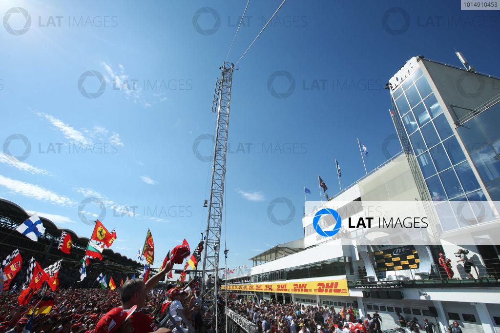 Hungaroring, Budapest, Hungary.  Sunday 30 July 2017. Ferrari fans celebrate after the race as Sebastian Vettel, Ferrari, 1st Position, arrives on the podium. World Copyright: Coates/LAT Images  ref: Digital Image AN7T9895
