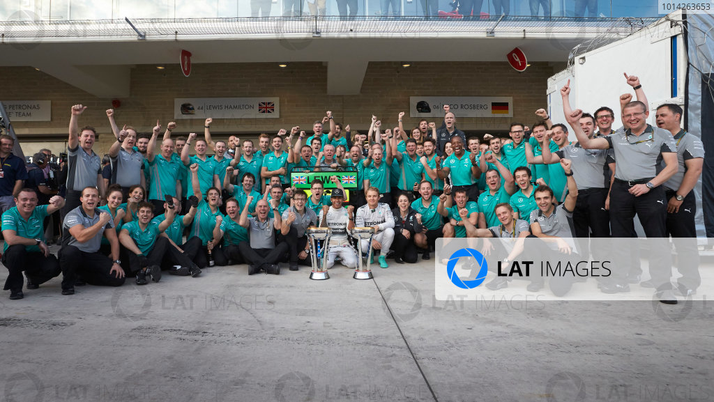 Circuit of the Americas, Austin, Texas, United States of America. Sunday 2 November 2014. Lewis Hamilton, Mercedes AMG celebrates with the team and Nico Rosberg, Mercedes AMG after winning the race. World Copyright: Steve Etherington/LAT Photographic. ref: Digital Image SNE10564