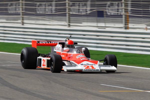 Bahrain International Circuit, Sakhir, Bahrain 13th March 2010 James Hunt's McLaren M23-Ford in the 60th Anniversary parade. Atmosphere.  World Copyright: Andrew Ferraro/LAT Photographic ref: Digital Image _Q0C8022