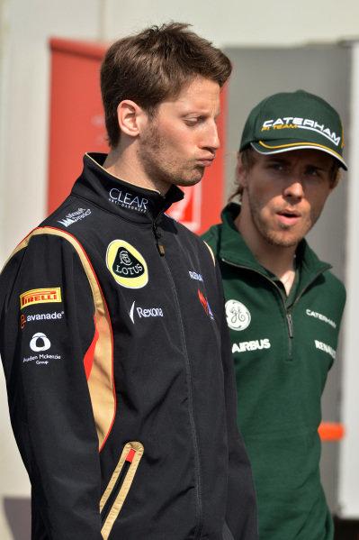 Romain Grosjean (FRA) Lotus F1 and Charles Pic (FRA) Caterham F1 Team. Formula One World Championship, Rd9, German Grand Prix, Practice, Nurburgring, Germany, Friday 5 July 2013.