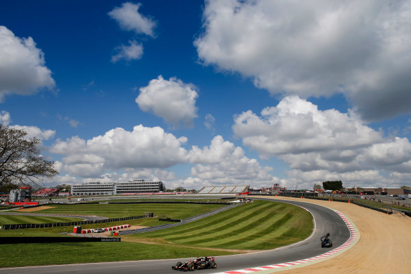 Brands Hatch, Kent, UK. Monday 27 April 2015. Romain Grosjean, Lotus E23 Mercedes on track followed by a filming car. World Copyright: Glenn Dunbar/LAT Photographic. ref: Digital Image _W2Q0403