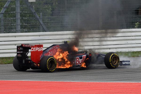 Hockenheimring, Hockenheim, Germany. Sunday 20 July 2014. Daniil Kvyat, Toro Rosso STR9 Renault, pulls over as fire engulfs his car. World Copyright: Steve Etherington/LAT Photographic. ref: Digital Image GER-RACE-3081