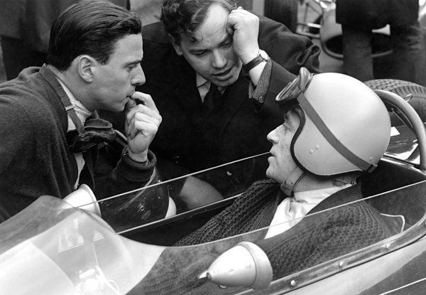 Reims, France. 28-30 June 1963 Jim Clark chats with Cosworth's, Neil Duckworth and in car, Peter Arundel, portrait. World Copyright: LAT Photographic Ref:  19800