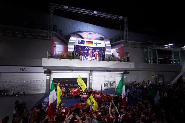 Marina Bay Circuit, Singapore. Sunday 20 September 2015. Sebastian Vettel, Ferrari, 1st Position, Daniel Ricciardo, Red Bull Racing, 2nd Position, and Kimi Raikkonen, Ferrari, 3rd Position, on the podium. World Copyright: Steve Etherington/LAT Photographic ref: Digital Image SNE15792