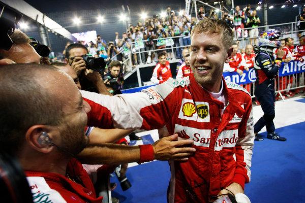 Marina Bay Circuit, Singapore. Sunday 20 September 2015. Sebastian Vettel, Ferrari, 1st Position, celebrates with his team in Parc Ferme.  World Copyright: Steven Tee/LAT Photographic. ref: Digital Image _L4R1918