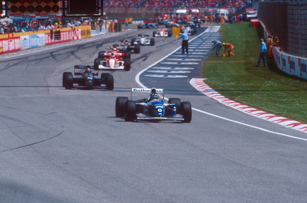 Imola, Italy.29/4-1/5 1994.Damon Hill (Williams FW16 Renault), Heinz-Harald Frentzen (Sauber C13 Ford) and others file around  behind the safety car, whilst marshalls clean up the track after the Lehto/Lamy startline shunt.Ref-94 SM 29.World Copyright - LAT Photographic