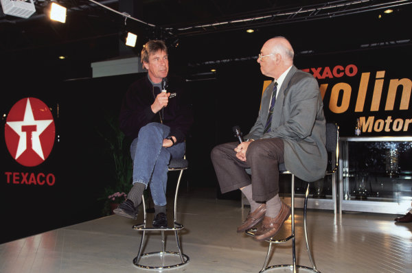 Birmingham NEC, England. January 1993. James Hunt and Murray Walker in conversation on the Texaco stand, portrait. World Copyright: LAT Photographic.