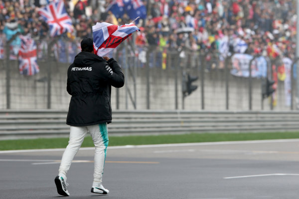 Shanghai International Circuit, Shanghai, China.  Friday 07 April 2017.  Lewis Hamilton, Mercedes AMG, takes to the track to entertain the fans and picks up a Union Flag. World Copyright: Charles Coates/LAT Images  ref: Digital Image AN7T4865