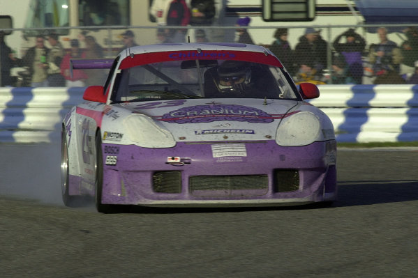 Rolex 24 at Daytona International Speedway 5-6 Feb 2000 Daytona Beach, Florida, USAThe Alex Job Racing Porshe (#23) locks a wheel entering the second horseshoe Saturday evening. This car lead GTU until the final hours before dropping out with engine trouble,having reached the top 10 as the SR entries retired.