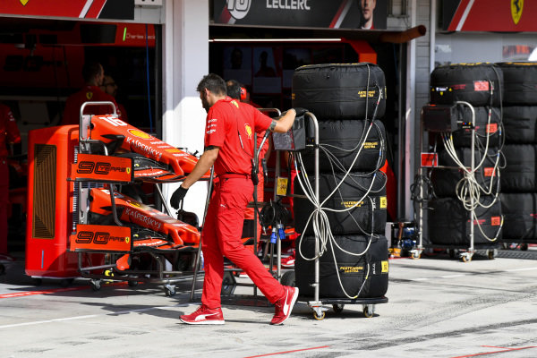 A Ferrari mechanic with some tyres