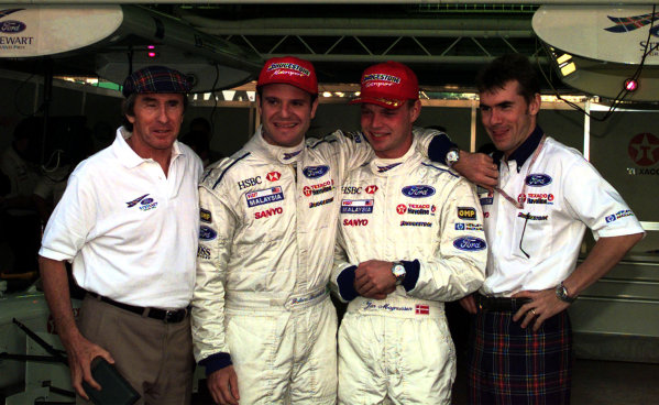 1997 Japanese Grand Prix.Suzuka, Japan.10-12 October 1997.Stewart-Ford confirm that they have resigned their drivers for next season. (L-R) Jackie Stewart, Rubens Barrichello, Jan Magnussen and Paul Stewart.World Copyright - LAT Photographic