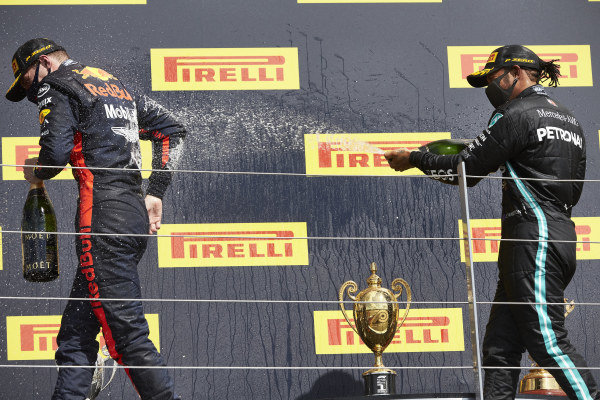 Lewis Hamilton, Mercedes-AMG Petronas F1, celebrates on the podium with Max Verstappen, Red Bull Racing
