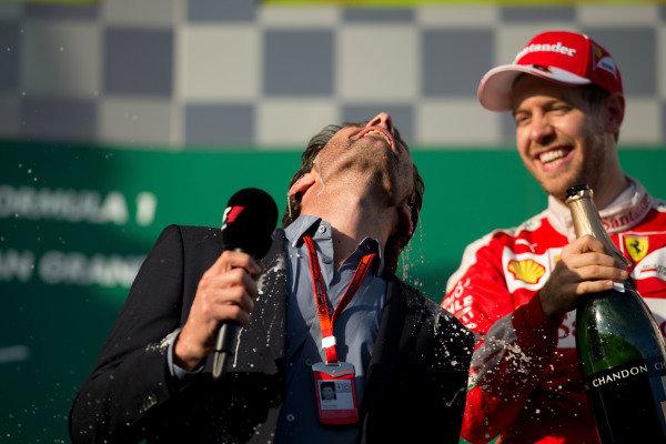 Sebastian Vettel (GER) Ferrari and Mark Webber (AUS) celebratewith champagne on the podium at Formula One World Championship, Rd1, Australian Grand Prix, Race, Albert Park, Melbourne, Australia, Sunday 20 March 2016.