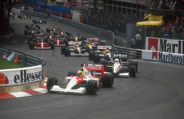 1991 Monaco Grand Prix.Monte Carlo, Monaco.26-28 April 1991.Ayrton Senna (McLaren MP4/6 Honda) leads Stefan Modena (Tyrrell 020 Honda), Riccardo Patrese, Nigel Mansell (both Williams FW14 Renault's), Nelson Piquet (Benetton B191 Ford) and Alain Prost (Ferrari 642) into Ste. Devote at the start.Ref-91 MON 15.World Copyright - LAT Photographic