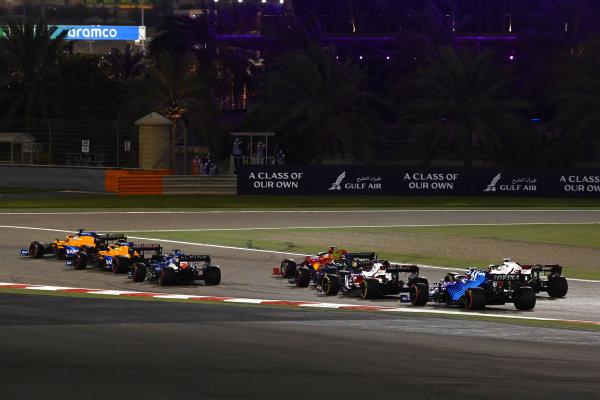 Daniel Ricciardo, McLaren MCL35M, leads Lando Norris, McLaren MCL35M, and Fernando Alonso, Alpine A521