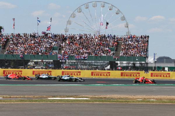 Sebastian Vettel (GER) Ferrari SF-71H leads at the start of the race