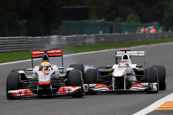 (L to R): Lewis Hamilton (GBR) McLaren MP4/26 and Kamui Kobayashi (JPN) Sauber C30 collide at Les Combes. Formula One World Championship, Rd 12, Belgian Grand Prix, Race, Spa-Francorchamps, Belgium, Sunday 28 August 2011.  BEST IMAGE